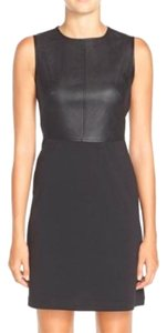Gabby Skye short dress BLACK Faux Leather Bodice Ponte Skirt Fitted on Tradesy