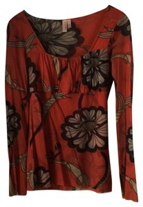 Sweet Pea by Stacy Frati Mesh Stretchy Top Orange with floral pattern