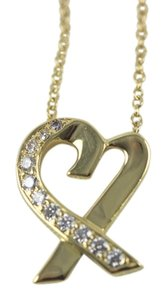 Tiffany & Co. 18k yellow gold and diamond Loving Heart necklace by Tiffany and Co.