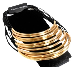 New York Jeweler Draping Gold Tones on Black Cording