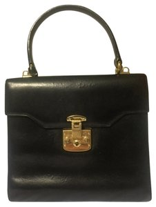 Gucci Satchel in black with red interior