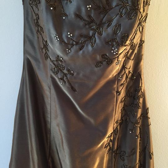 Jovani Bronze with Green and Gold Shimmer. Polyester Asymmetric Detail Tones Gown. Can Be Used For A Or Prom. Traditional Bridesmaid/Mob Dress Size 10 (M)
