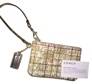 Coach Wallet Leather Wristlet in gold