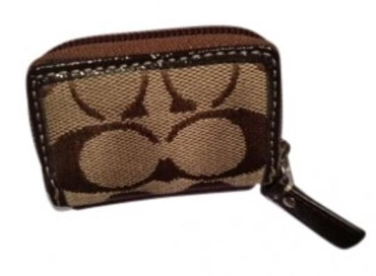 Preload https://item5.tradesy.com/images/coach-brown-contact-lens-case-137539-0-0.jpg?width=440&height=440