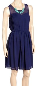 Danny & Nicole Classic Sleeveless Sheer Pleated Dress