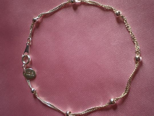 Preload https://img-static.tradesy.com/item/137570/claire-s-like-new-silvertone-chain-and-beads-bracelet-0-0-540-540.jpg
