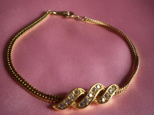 Preload https://item3.tradesy.com/images/avon-gold-like-new-chain-wcrystals-bracelet-137587-0-0.jpg?width=440&height=440