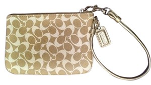 Coach Wristlet in beige and white