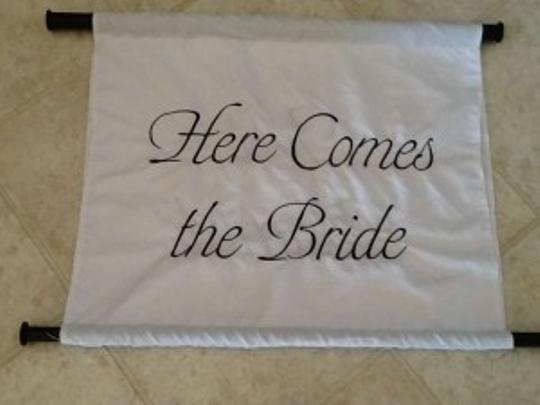 White with Black Font Here Comes The Bride Sign.