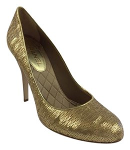 Chanel Gold Pumps