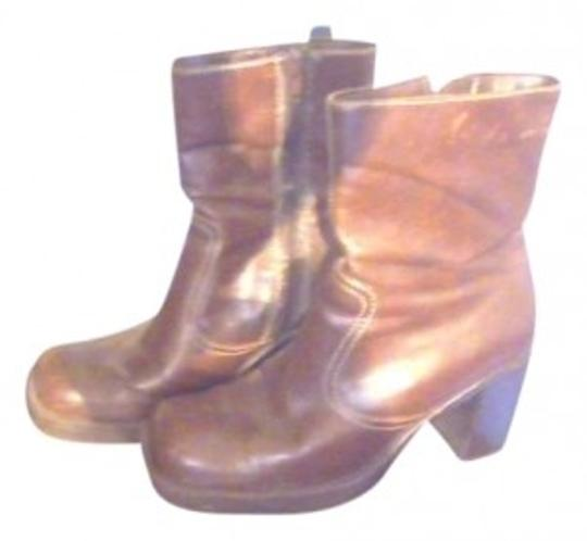 Preload https://img-static.tradesy.com/item/139439/carolina-herrera-brown-leather-with-inner-of-has-a-zipper-bootsbooties-size-us-7-0-0-540-540.jpg
