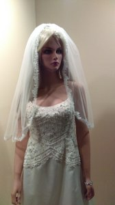 Soft Elbow Length Veil With Lace Edging And Comb Attached