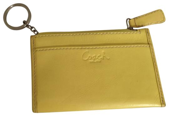 Preload https://item3.tradesy.com/images/coach-yellow-coin-purse-wallet-139827-0-0.jpg?width=440&height=440