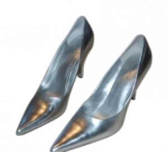 Preload https://item2.tradesy.com/images/nine-west-silver-pointed-pumps-size-us-95-139891-0-0.jpg?width=440&height=440