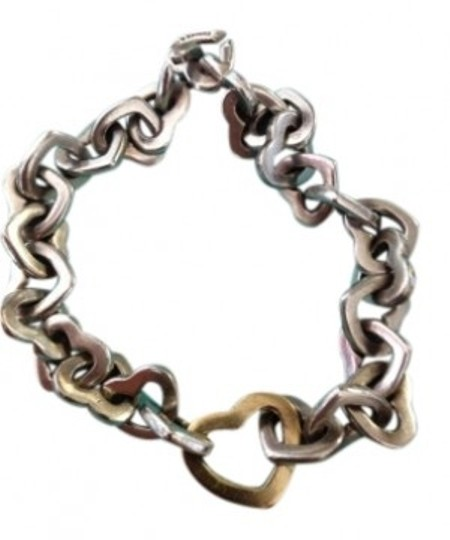 Preload https://item5.tradesy.com/images/tiffany-and-co-sterling-silver-with-18k-gold-heart-link-bracelet-139904-0-0.jpg?width=440&height=440