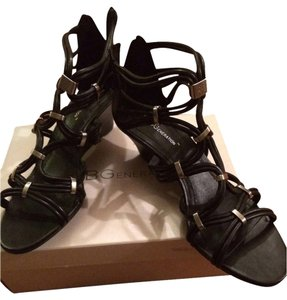 BCBGMAXAZRIA Summer Black Gladiators Leather Black leather Sandals