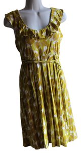 New York & Company short dress yellow, ivory on Tradesy