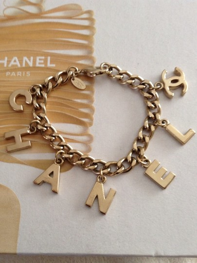 Chanel Authentic Chanel Stamped '04 Gold Plated Charm Letter Bracelet