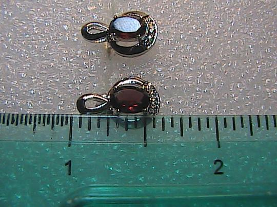 Unknown Sterling Silver 1.6 carats Oval Garnet and White Topaz Stud Earrings