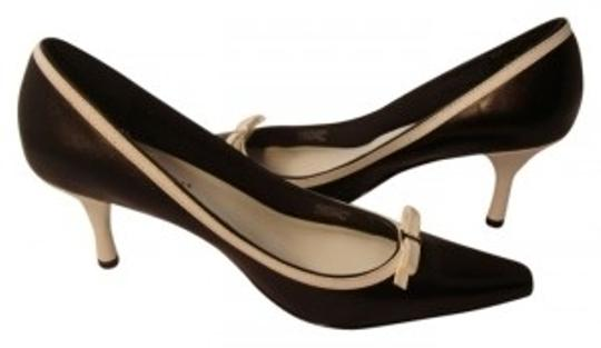 Preload https://item5.tradesy.com/images/etienne-aigner-black-and-white-classic-yet-flirty-b-and-w-pumps-size-us-7-regular-m-b-14054-0-0.jpg?width=440&height=440