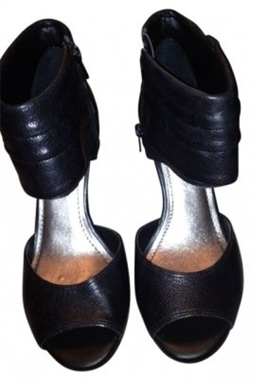 Preload https://item2.tradesy.com/images/gianni-bini-black-new-leather-and-fab-pumps-size-us-75-140686-0-0.jpg?width=440&height=440