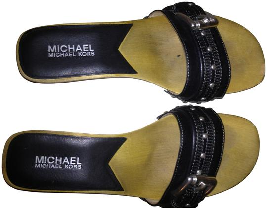 Preload https://img-static.tradesy.com/item/140698/michael-kors-wood-and-black-leather-studded-by-sandals-size-us-75-0-0-540-540.jpg
