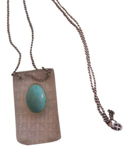 Carved Lucite Pendant on Sterling Chain