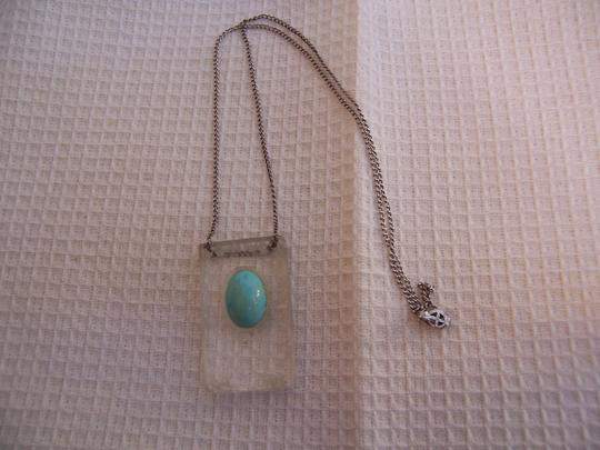 Other Carved Lucite Pendant on Sterling Chain