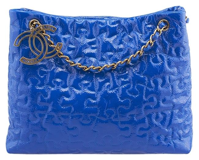 Item - Puzzle Quilted Large Shopper (78642) Blue Patent Leather Tote