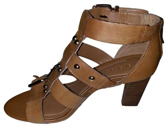 Preload https://item5.tradesy.com/images/bcbgeneration-brown-strappy-heel-with-gold-ribots-and-buckles-sandals-size-us-65-regular-m-b-1410369-0-0.jpg?width=440&height=440