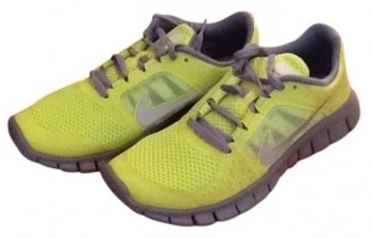 Preload https://img-static.tradesy.com/item/141134/nike-neon-yellow-and-grey-sneakers-size-us-55-0-0-540-540.jpg