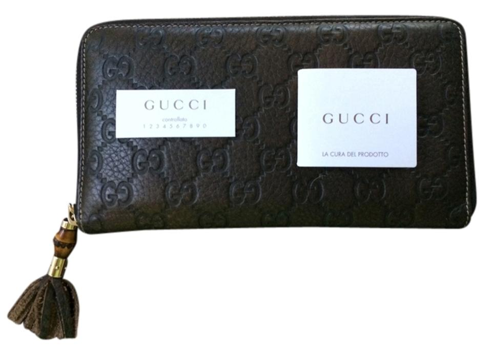 3de88cc97638 Gucci 100% authentic pre-owned, Gucci monogram leather zip around wallet ...