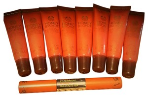 "The Body Shop 8 ""The Body Shop"" honey bronze lip gloss & VITAMIN C-eye reviver duo"