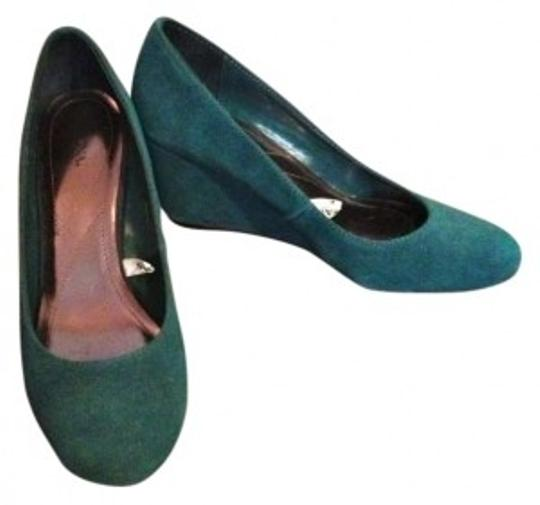 Preload https://item1.tradesy.com/images/merona-teal-suede-wedges-size-us-10-141260-0-0.jpg?width=440&height=440