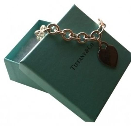 Preload https://item2.tradesy.com/images/tiffany-and-co-sterling-silver-heart-tag-charm-bracelet-14131-0-0.jpg?width=440&height=440