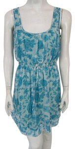Nikibiki short dress Blue Sleeveless Floral on Tradesy