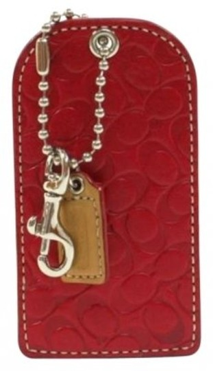 Preload https://item1.tradesy.com/images/coach-red-leather-luggage-tag-signature-logo-never-used-141775-0-0.jpg?width=440&height=440