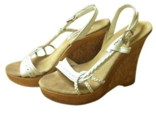 Preload https://img-static.tradesy.com/item/141796/steve-madden-white-leather-strapping-wedges-size-us-65-0-0-540-540.jpg