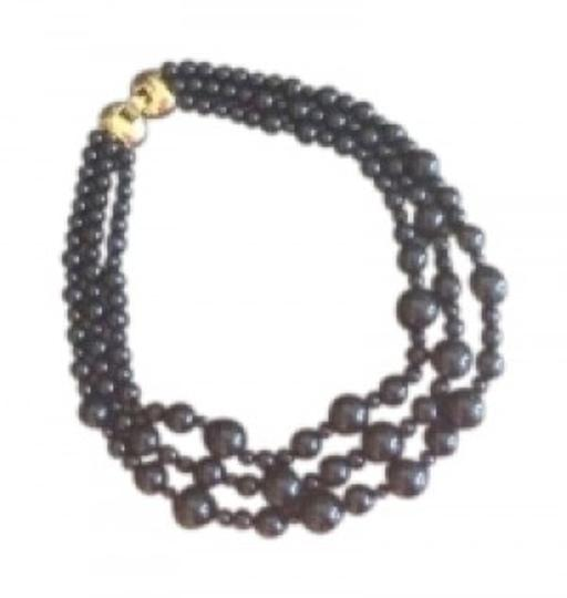 Preload https://item4.tradesy.com/images/monet-black-vintage-3-string-bead-w-bow-hardware-necklace-141878-0-0.jpg?width=440&height=440