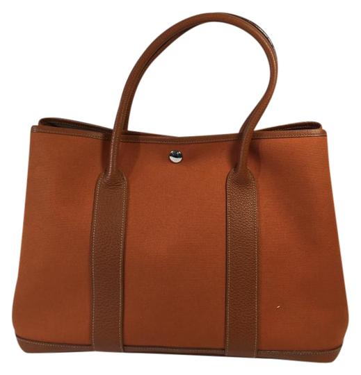 Preload https://item1.tradesy.com/images/hermes-garden-party-burnt-orange-canvas-and-leather-tote-1421505-0-2.jpg?width=440&height=440