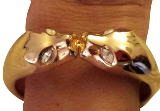 Preload https://item3.tradesy.com/images/gold-finish-with-dual-cougar-heads-two-braceletwhite-rhinestone-eyes-bracelet-1421852-0-0.jpg?width=440&height=440
