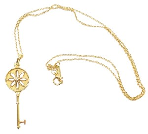 Tiffany & Co. Tiffany & Co 18K Yellow Gold Diamond Daisy Key Pendant
