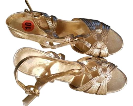 Ivanka Trump gold and silver Wedges
