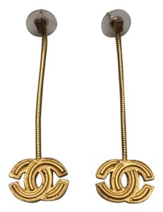 Chanel Dangling Chena Earrings with gold CC pierced.