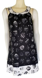 BCBGMAXAZRIA short dress Black Pull-on White Trapeze on Tradesy