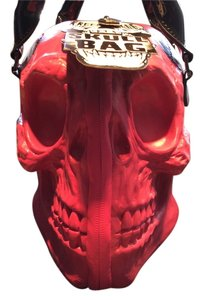 Kreepsville Skull Satchel in Hot pink with patent black handles