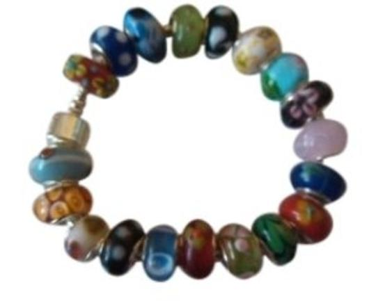 Preload https://item1.tradesy.com/images/multicolor-loaded-beaded-murano-lampwork-glass-silver-18-beads-bracelet-142995-0-0.jpg?width=440&height=440