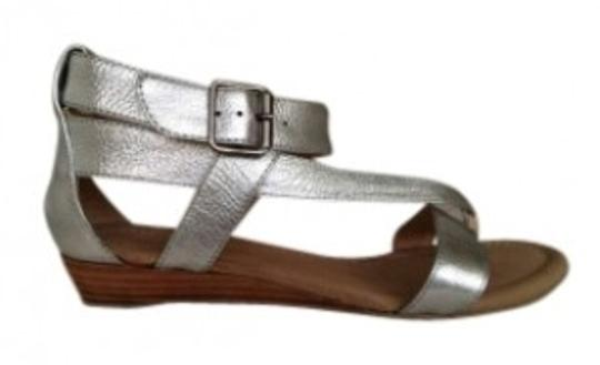 Preload https://item1.tradesy.com/images/matisse-matte-silver-or-matte-gold-new-leather-gladiator-wedge-in-sandals-size-us-7-143150-0-0.jpg?width=440&height=440