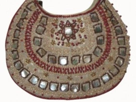 Preload https://item5.tradesy.com/images/the-limited-tribal-beaded-neutral-tan-with-red-linen-beading-hobo-bag-143324-0-0.jpg?width=440&height=440