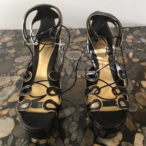 Alexander McQueen Black and Gold Platforms